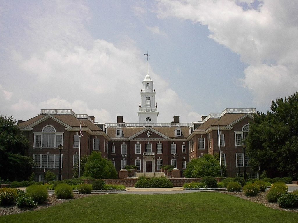 The Delaware State Capitol (or Legislative Hall) in Dover, Delaware, illustrating a page about collections services in New York State.