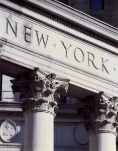 Architectural detail of a New York building illustrating a web page about collections services in New York State.