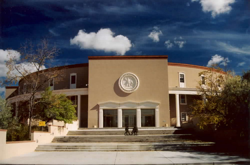 New Mexico Capitol in Santa Fe, illustrating a page about collections services in New York State.