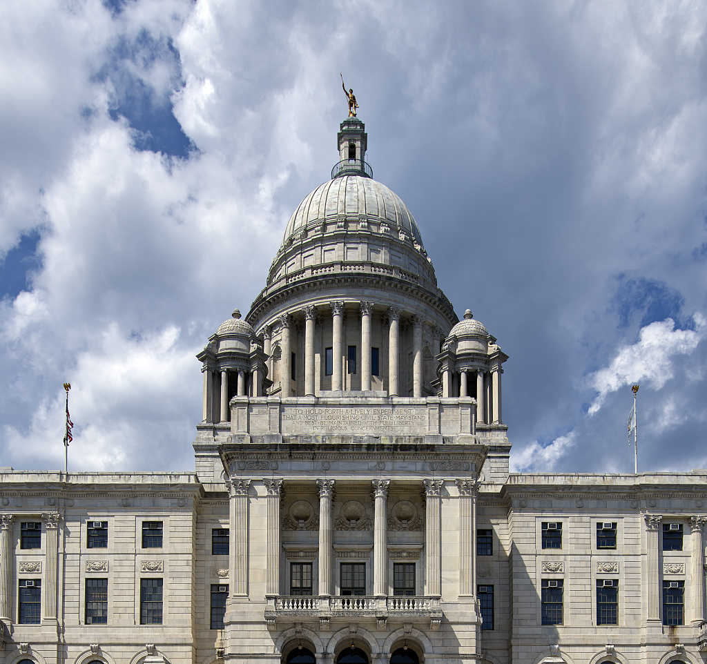 The Rhode Island State House, the capitol building of that Eastern Seaboard state. It houses the Rhode Island General Assembly and the offices of the governor and other high state officials, illustrating page about collections services in New York State.