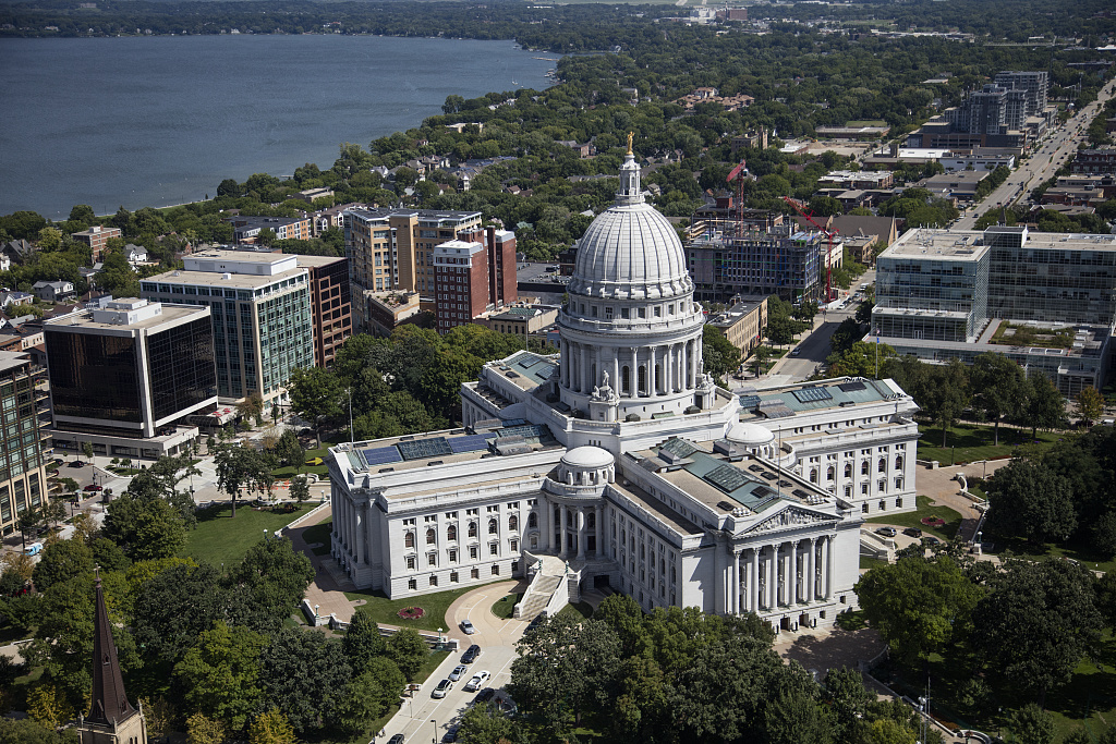 Aerial view of the Wisconsin State Capitol in Madison, illustrating a page about collections services in New York State.