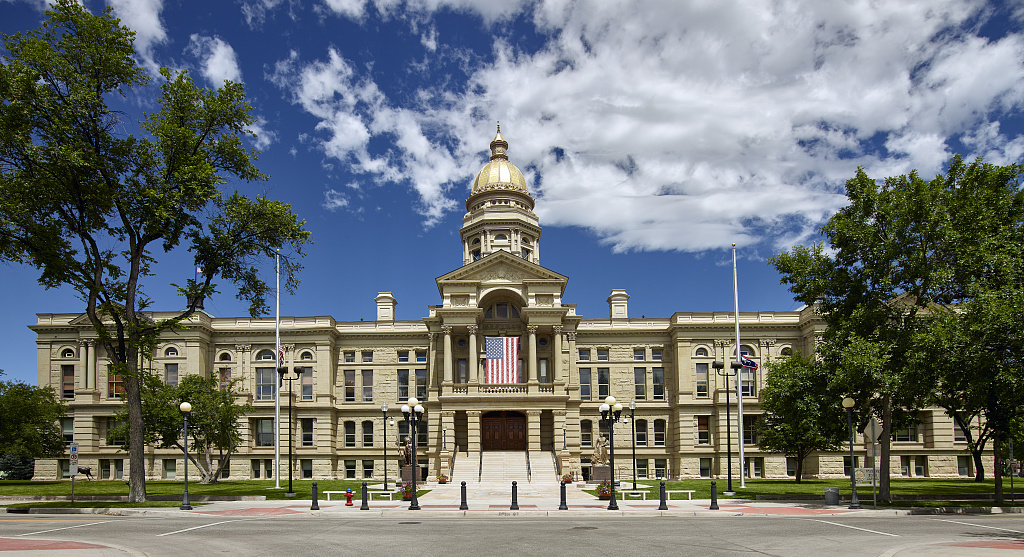The state capitol in Cheyenne, the largest city in Wyoming. The building's cornerstone was laid in 1887, three years before Wyoming graduated from territorial status to statehood, illustrating page about collections services in New York State.