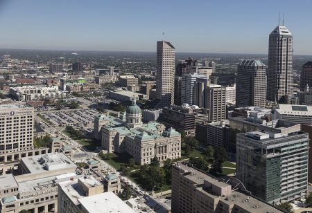 Aerial view of Indianapolis, Indiana, with a focus on the Indiana State House, illustrating a page about collections services in New York State.