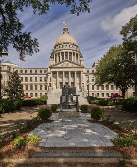 Mississippi State Capitol in Jackson, illustrating a page about collections services in New York State.
