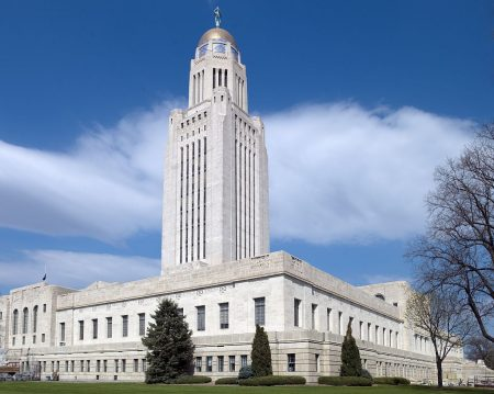 Nebraska Capitol building in Lincoln, illustrating a page about collections services in New York State.