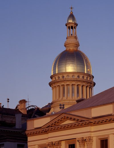 New Jersey State Capitol building in Trenton, illustrating a page about collections services in New York State.