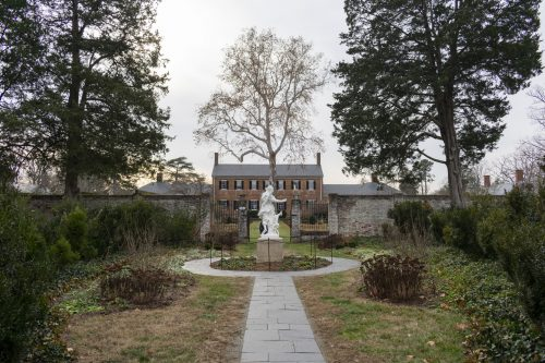 Chatham Manor, Virginia, a large house with garden and statue in foreground, illustrating a page about collections services in New York State, for Virginia businesses.